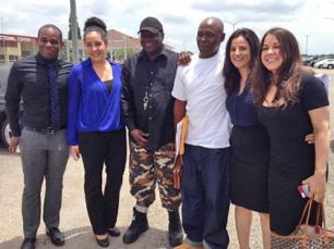 Photo: Nathan Brown (white shirt) with exoneree Michael Williams (black hat) and his legal team. - Innocence Project